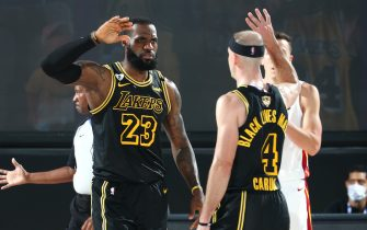 ORLANDO, FL - OCTOBER 2: LeBron James #23 high-fives Alex Caruso #4 of the Los Angeles Lakers during Game Two of the NBA Finals on October 2, 2020 at AdventHealth Arena in Orlando, Florida. NOTE TO USER: User expressly acknowledges and agrees that, by downloading and/or using this Photograph, user is consenting to the terms and conditions of the Getty Images License Agreement. Mandatory Copyright Notice: Copyright 2020 NBAE (Photo by Nathaniel S. Butler/NBAE via Getty Images)