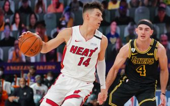 ORLANDO, FL - OCTOBER 02: Tyler Herro #14 of the Miami Heat drives to the basket around Alex Caruso #4 of the Los Angeles Lakers during Game Two of the NBA Finals on October 2, 2020 in Orlando, Florida at AdventHealth Arena. NOTE TO USER: User expressly acknowledges and agrees that, by downloading and/or using this Photograph, user is consenting to the terms and conditions of the Getty Images License Agreement. Mandatory Copyright Notice: Copyright 2020 NBAE (Photo by Jesse D. Garrabrant/NBAE via Getty Images)