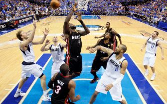 Dallas Mavericks' (from left wearing white) Dirk Nowitzki (41), Jason Kidd (2), Tyson Chandler (6) and Jose Juan Barea (11) go up for a rebound against Miami Heats' (from left wearing black) Dwyane Wade (3), Lebron James (6), Udonis Haslem (40) and Chris Bosh (1) during game 5 of the NBA Finals on June 9, 2011 at the American Airlines Center in Dallas, Texas.    AFP PHOTO / POOL / LUCY NICHOLSON (Photo credit should read LUCY NICHOLSON/AFP via Getty Images)
