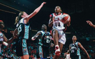 HOUSTON - AUGUST 26: Cynthia Cooper #14 of the Houston Comets attempts a layup against the New York Liberty during Game 2 of the 2000 WNBA Finals played August 26, 2000 at the Summit in Houston, Texas. NOTE TO USER: User expressly acknowledges that, by downloading and or using this photograph, User is consenting to the terms and conditions of the Getty Images License agreement. Mandatory Copyright Notice: Copyright 2006 NBAE (Photo by Bill Baptist/NBAE via Getty Images)