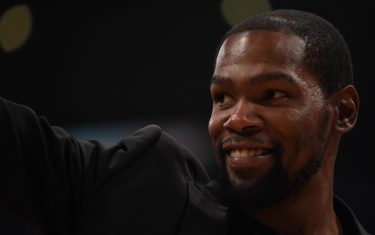 LOS ANGELES, CALIFORNIA - MARCH 10:  Kevin Durant #7 of the Brooklyn Nets smiles during the second half against the Los Angeles Lakers at Staples Center on March 10, 2020 in Los Angeles, California. (Photo by Harry How/Getty Images)  NOTE TO USER: User expressly acknowledges and agrees that, by downloading and or using this photograph, User is consenting to the terms and conditions of the Getty Images License Agreement.