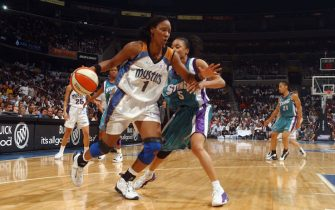WASHINGTON - AUGUST 15:  Chamique Holdsclaw #1 of the Washington Mystics drives past Dawn Staley #5 of the Charlotte Sting in Game one of the Eastern Conference Semifinals during the 2002 WNBA Playoffs on August 15, 2002 at MCI Center in Washington, D.C.  The Mystics won 74-62.  NOTE TO USER: User expressly acknowledges and agrees that, by downloading and/or using this Photograph, User is consenting to the terms and conditions of the Getty Images License Agreement Mandatory Copyright Notice:  Copyright 2002 WNBAE  (Photo by Mitchell Layton/WNBAE/Getty Images)