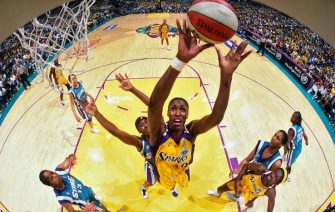 LOS ANGELES - SEPTEMBER 1: Lisa Leslie #9 of the Los Angeles Sparks rebounds during Game Two of the 2001 WNBA Finals on September 1, 2001 at the Staples Center in Los Angeles, California. NOTE TO USER: User expressly acknowledges and agrees that, by downloading and or using this photograph, User is consenting to the terms and conditions of the Getty Images License Agreement. Mandatory Copyright Notice: Copyright 2001 NBAE (Photo by Andrew D. Bernstein/NBAE via Getty Images)