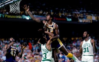 BOSTON - JUNE 12:  Magic Johnson #32 of the Los Angeles Lakers shoots a layup against Gerald Henderson #43 of the Boston Celtics during Game Seven of the 1984 NBA Finals played on June 12 at the Boston Garden in Boston, Massachusetts. The Boston Celtics defeated the Los Angeles Lakers 111-102 and won the series 4-3 to capture the 1984 NBA Championship. NOTE TO USER: User expressly acknowledges that, by downloading and or using this photograph, User is consenting to the terms and conditions of the Getty Images License agreement. Mandatory Copyright Notice: Copyright 1984 NBAE (Photo by Dick Raphael/NBAE via Getty Images)