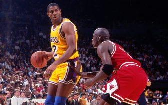INGLEWOOD, CA - JUNE 12: Magic Johnson #32 of the Los Angeles Lakers post up against Michael Jordan #23 of the Chicago Bulls during Game Five of the 1991 NBA Finals on June 12, 1991 at the Great Western Forum in Inglewood, California. NOTE TO USER: User expressly acknowledges and agrees that, by downloading and/or using this Photograph, user is consenting to the terms and conditions of the Getty Images License Agreement. Mandatory Copyright Notice: Copyright 1991 NBAE (Photo by Andrew D. Bernstein/NBAE via Getty Images)