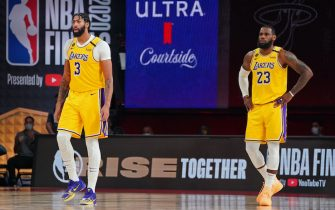 ORLANDO, FL - OCTOBER 06: Anthony Davis #3 and LeBron James #23 of the Los Angeles Lakers stand on the court during Game Four of the NBA Finals against the Miami Heat on October 6, 2020 in Orlando, Florida at AdventHealth Arena. NOTE TO USER: User expressly acknowledges and agrees that, by downloading and/or using this Photograph, user is consenting to the terms and conditions of the Getty Images License Agreement. Mandatory Copyright Notice: Copyright 2020 NBAE (Photo by Jesse D. Garrabrant/NBAE via Getty Images)