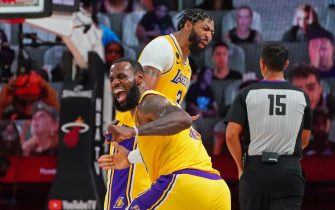 ORLANDO, FL - OCTOBER 06: LeBron James #23 and Anthony Davis #3 of the Los Angeles Lakers yell and celebrate during Game Four of the NBA Finals against the Miami Heat on October 6, 2020 in Orlando, Florida at AdventHealth Arena. NOTE TO USER: User expressly acknowledges and agrees that, by downloading and/or using this Photograph, user is consenting to the terms and conditions of the Getty Images License Agreement. Mandatory Copyright Notice: Copyright 2020 NBAE (Photo by Jesse D. Garrabrant/NBAE via Getty Images)