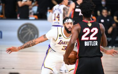 ORLANDO, FL - OCTOBER 4: Anthony Davis #3 of the Los Angeles Lakers plays defense against Jimmy Butler #22 of the Miami Heat during Game Three of the NBA Finals on October 4, 2020 at the AdventHealth Arena at ESPN Wide World Of Sports Complex in Orlando, Florida. NOTE TO USER: User expressly acknowledges and agrees that, by downloading and/or using this Photograph, user is consenting to the terms and conditions of the Getty Images License Agreement. Mandatory Copyright Notice: Copyright 2020 NBAE (Photo by Garrett Ellwood/NBAE via Getty Images)