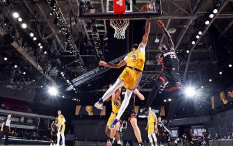 ORLANDO, FL - OCTOBER 6: Anthony Davis #3 of the Los Angeles Lakers blocks the shot by Kendrick Nunn #25 of the Miami Heat during Game Four of the NBA Finals on October 6, 2020 at The AdventHealth Arena at ESPN Wide World Of Sports Complex in Orlando, Florida. NOTE TO USER: User expressly acknowledges and agrees that, by downloading and/or using this Photograph, user is consenting to the terms and conditions of the Getty Images License Agreement. Mandatory Copyright Notice: Copyright 2020 NBAE (Photo by Andrew D. Bernstein/NBAE via Getty Images)