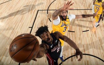 ORLANDO, FL - OCTOBER 6: Jimmy Butler #22 of the Miami Heat drives to the basket while Anthony Davis #3 of the Los Angeles Lakers plays defense during Game Four of the NBA Finals on October 6, 2020 at The AdventHealth Arena at ESPN Wide World Of Sports Complex in Orlando, Florida. NOTE TO USER: User expressly acknowledges and agrees that, by downloading and/or using this Photograph, user is consenting to the terms and conditions of the Getty Images License Agreement. Mandatory Copyright Notice: Copyright 2020 NBAE (Photo by Andrew D. Bernstein/NBAE via Getty Images)