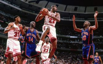 CHICAGO, IL - MARCH 21: John Salley #22 of the Chicago Bulls grabs the rebound against the New York Knicks on March 21, 1996 at the United Center in Chicago, Illinois. NOTE TO USER: User expressly acknowledges and agrees that, by downloading and/or using this photograph, user is consenting to the terms and conditions of the Getty Images License Agreement. Mandatory Copyright Notice: Copyright 1996 NBAE (Photo by Ron Modra/NBAE via Getty Images)