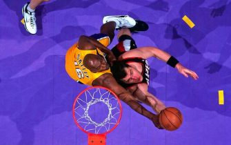 LOS ANGELES - MAY 22:  Arvydas Sabonis #11 of the Portland Trail Blazer shoots a layup against John Salley #16 of the Los Angeles Lakers in Game Two of the Western Conference Finals during the 2000 NBA Playoffs at Staples Center on May 22, 2000 in Los Angeles, California.  The Blazers defeated the Lakers 106-77.  NOTE TO USER: User expressly acknowledges and agrees that, by downloading and or using this photograph, User is consenting to the terms and conditions of the Getty Images License Agreement. Mandatory Copyright Notice: Copyright 2000 NBAE (Photo by Andrew D. Bernstein/NBAE via Getty Images)