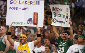 BOSTON - JUNE 8:  A Lakers fan holds a sign that shows support for Kobe Bryant #24 as a Boston fan hold a sign in support of the Celtics during Game Two of the 2008 NBA Finals between the Los Angeles and the Boston Celtics at TD Banknorth Garden on June 8, 2008 in Boston, Massachusetts.  The Celtics won 108-102.  NOTE TO USER: User expressly acknowledges and agrees that, by downloading and/or using this Photograph, user is consenting to the terms and conditions of the Getty Images License Agreement. Mandatory Copyright Notice: Copyright 2008 NBAE (Photo by David Sherman/NBAE via Getty Images)