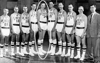 MINNEAPOLIS - 1954:  The 1953-54 NBA World Champion Minneapolis Lakers (from left to right): #22 Slater Martin, #18 Frank Saul, #12 Jim Holstein, #17 Jim Pollard, #34 Clyde Lovellette, #99 George Mikan, #19 Vern Mikkelsen, #15 Dick Schnittker, #20 Whitey Skoog and head coach John Kundla pose for a team photo in Minneapolis, Minnesota.  NOTE TO USER: User expressly acknowledges  and agrees that, by downloading and or using this  photograph, User is consenting to the terms and conditions of the Getty Images License Agreement. Mandatory copyright notice: Copyright NBAE 1954 (Photo by NBA Photos Library/NBAE via Getty Images)