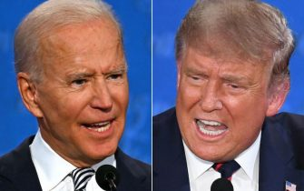 TOPSHOT - (COMBO) This combination of pictures created on September 29, 2020 shows Democratic Presidential candidate and former US Vice President Joe Biden (L) and US President Donald Trump speaking during the first presidential debate at the Case Western Reserve University and Cleveland Clinic in Cleveland, Ohio on September 29, 2020. (Photos by JIM WATSON and SAUL LOEB / AFP) (Photo by JIM WATSON,SAUL LOEB/AFP via Getty Images)
