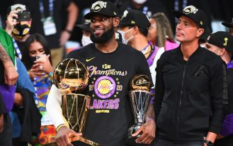 ORLANDO, FL - OCTOBER 11: LeBron James #23 of the Los Angeles Lakers celebrates after receiving the Bill Russell Finals MVP Trophy and the Larry O'Brien Trophy after Game Six of the NBA Finals on October 11, 2020 at the AdventHealth Arena at ESPN Wide World Of Sports Complex in Orlando, Florida. NOTE TO USER: User expressly acknowledges and agrees that, by downloading and/or using this Photograph, user is consenting to the terms and conditions of the Getty Images License Agreement. Mandatory Copyright Notice: Copyright 2020 NBAE (Photo by Garrett Ellwood/NBAE via Getty Images)