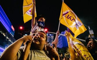 LOS ANGELES, CA - OCTOBER 11: Lakers fans celebrate in front of the Staples Center on October 11, 2020 in Los Angeles, California. People gathered to celebrate after the Los Angeles Lakers defeated the Miami Heat in Game 6 of the NBA Finals. (Photo by Brandon Bell/Getty Images)