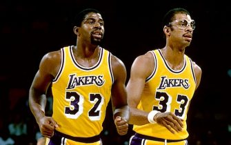 LOS ANGELES - 1987: Magic Johnson #32 and Kareem Abdul-Jabbar #33 of the Los Angeles Lakers walk off the court during the NBA game against the New Jersey Nets at the Forum in Los Angeles, California.  NOTE TO USER: User expressly acknowledges and agrees that, by downloading and or using this photograph, User is consenting to the terms and conditions of the Getty Images License Agreement. Mandatory Copyright Notice: Copyright 1987 NBAE (Photo by Andrew D. Bernstein/NBAE via Getty Images)