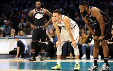 CHARLOTTE, NORTH CAROLINA - FEBRUARY 17:  Stephen Curry #30 of the Golden State Warriors and Team Giannis smiles and James Harden #13 of the Houston Rockets and Team LeBron smile in the third quarter during the NBA All-Star game as part of the 2019 NBA All-Star Weekend at Spectrum Center on February 17, 2019 in Charlotte, North Carolina.  NOTE TO USER: User expressly acknowledges and agrees that, by downloading and/or using this photograph, user is consenting to the terms and conditions of the Getty Images License Agreement.  (Photo by Streeter Lecka/Getty Images)