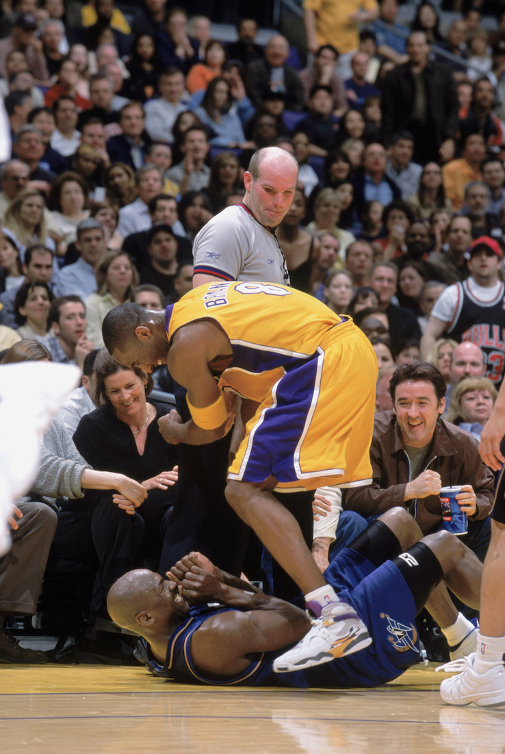 LOS ANGELES - MARCH 28:  Kobe Bryant #8 of the Los Angeles Lakers plays with Michael Jordan #23 of the Washington Wizards during the NBA game at Staples Center on March 28, 2003 in Los Angeles, California. The Lakers won 108-94.  NOTE TO USER: User expressly acknowledges and agrees that, by downloading and/or using this Photograph, User is consenting to the terms and conditions of the Getty Images License Agreement. Mandatory copyright notice:  Copyright 2003 NBAE (Photo by: Nathaniel S. Butler/NBAE via Getty Images)