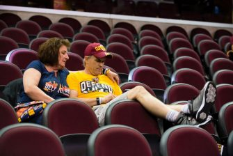 CLEVELAND, OH - JUNE 04: Two Cars fans remain in their seat inside The Quicken Loans Arena after attending an NBA Finals Game Two watch party between the Cleveland Cavaliers and the Golden State Warriors on June 4, 2017 in Cleveland, Ohio. Golden State defeated defending NBA Champion Cleveland 132-113 to take a 2-0 lead in the best of seven series. (Photo by Angelo Merendino/Getty Images)