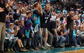 CHARLOTTE, NC - OCTOBER 23:  Charlotte Hornets fans cheer during the game against the Chicago Bulls on October 23, 2019 at Spectrum Center in Charlotte, North Carolina. NOTE TO USER: User expressly acknowledges and agrees that, by downloading and or using this photograph, User is consenting to the terms and conditions of the Getty Images License Agreement.  Mandatory Copyright Notice:  Copyright 2019 NBAE (Photo by Brock Williams-Smith/NBAE via Getty Images)
