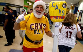 CLEVELAND, OH - MAY 26: A Cleveland Cavaliers fan dressed as Santa Claus holds an inflatable broom before Game Four of the Eastern Conference Finals against the Atlanta Hawks of the 2015 NBA Playoffs at Quicken Loans Arena on May 26, 2015 in Cleveland, Ohio. NOTE TO USER: User expressly acknowledges and agrees that, by downloading and or using this Photograph, user is consenting to the terms and conditions of the Getty Images License Agreement.  (Photo by Gregory Shamus/Getty Images)