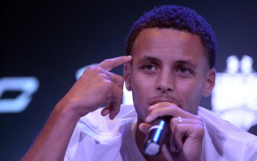 "National Basketball Association (NBA) Golden State Warriors and 2014-2015 season Most Valuable Player (MVP) Stephen Curry gestures during a press conference in Manila on September 5, 2015. Curry started his three-nation (Japan, China and Philippines) Under Armour Asia tour to promote the company's limited edition basketball shoes, ""UA Curry II"". AFP PHOTO /  NOEL CELIS        (Photo credit should read NOEL CELIS/AFP via Getty Images)"