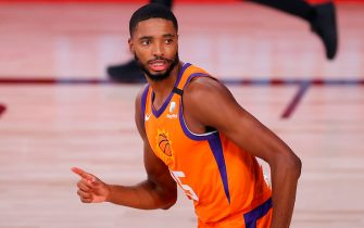 LAKE BUENA VISTA, FLORIDA - AUGUST 06: Mikal Bridges #25 of the Phoenix Suns reacts after a slam dunk during the second quarter the Indiana Pacers at Visa Athletic Center at ESPN Wide World Of Sports Complex on August 06, 2020 in Lake Buena Vista, Florida. NOTE TO USER: User expressly acknowledges and agrees that, by downloading and or using this photograph, User is consenting to the terms and conditions of the Getty Images License Agreement. (Photo by Kevin C. Cox/Getty Images)
