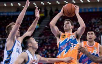 BEIJING, CHINA - NOVEMBER 15:  Jimmer Fredette #32 of Shanghai Sharks in action during the 2017/2018 CBA League match between Beijing Ducks and Shanghai Sharks at Cadillac Arena on November 15, 2017 in Beijing, China.  (Photo by XIN LI/Getty Images)