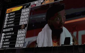 Orlando, FL - AUGUST 23: Donovan Mitchell #45 of the Utah Jazz is interviewed on the court after the game with his 51 point total on the scoreboard during Round One Game Four of the NBA Playoffs against the Denver Nuggets on August 23, 2020 at The AdventHealth Arena at ESPN Wide World Of Sports Complex in Orlando, Florida. NOTE TO USER: User expressly acknowledges and agrees that, by downloading and/or using this Photograph, user is consenting to the terms and conditions of the Getty Images License Agreement. Mandatory Copyright Notice: Copyright 2020 NBAE (Photo by Garrett Ellwood/NBAE via Getty Images)