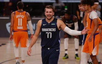 ORLANDO, FL - AUGUST 13: Luka Doncic #77 of the Dallas Mavericks against the Phoenix Suns as part of the NBA Restart 2020 on August 13, 2020 at Visa Athletic Center at ESPN Wide World of Sports Complex in Orlando, Florida. NOTE TO USER: User expressly acknowledges and agrees that, by downloading and/or using this photograph, user is consenting to the terms and conditions of the Getty Images License Agreement.  Mandatory Copyright Notice: Copyright 2020 NBAE (Photo by Jim Poorten/NBAE via Getty Images)