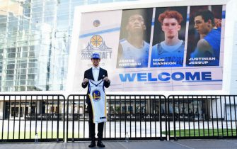 SAN FRANCISCO, CA - NOVEMBER 19: Nico Mannion of the Golden State Warriors smiles and poses for a photo during a draftee press conference on November 19, 2020 in San Francisco, California at the Chase Center. NOTE TO USER: User expressly acknowledges and agrees that, by downloading and or using this photograph, user is consenting to the terms and conditions of Getty Images License Agreement. Mandatory Copyright Notice: Copyright 2020 NBAE (Photo by Noah Graham/NBAE via Getty Images)