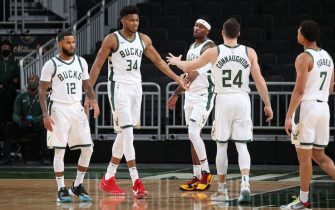 MILWAUKEE, WI - December 12: Giannis Antetokounmpo #34, Torrey Craig #3 and Pat Connaughton #24 of the Milwaukee Bucks hi-five during a preseason game against the Dallas Mavericks on December 12, 2020 at the Fiserv Forum Center in Milwaukee, Wisconsin. NOTE TO USER: User expressly acknowledges and agrees that, by downloading and or using this Photograph, user is consenting to the terms and conditions of the Getty Images License Agreement. Mandatory Copyright Notice: Copyright 2020 NBAE (Photo by Gary Dineen/NBAE via Getty Images).