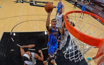 SAN ANTONIO, TX - DECEMBER 12: Theo Maledon #11 of the Oklahoma City Thunder drives to the basket against the San Antonio Spurs during a preseason game on December 12, 2020 at AT&T Center in San Antonio, Texas. NOTE TO USER: User expressly acknowledges and agrees that, by downloading and or using this Photograph, user is consenting to the terms and conditions of the Getty Images License Agreement. Mandatory Copyright Notice: Copyright 2020 NBAE (Photo by Logan Riely/NBAE via Getty Images)