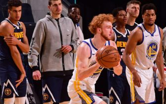 SAN FRANCISCO, CA - DECEMBER 12: Nico Mannion #2 of the Golden State Warriors passes the ball against the Denver Nuggets during a preseason game on December 12, 2020 in San Francisco, California at the Chase Center. NOTE TO USER: User expressly acknowledges and agrees that, by downloading and or using this photograph, user is consenting to the terms and conditions of Getty Images License Agreement. Mandatory Copyright Notice: Copyright 2020 NBAE (Photo by Noah Graham/NBAE via Getty Images)