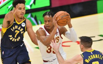 CLEVELAND, OHIO - DECEMBER 12: Isaac Okoro #35 of the Cleveland Cavaliers drives past Malcolm Brogdon #7 and T.J. McConnell #9 of the Indiana Pacers during the first half of a preseason game at Rocket Mortgage Fieldhouse on December 12, 2020 in Cleveland, Ohio. NOTE TO USER: User expressly acknowledges and agrees that, by downloading and/or using this Photograph, user is consenting to the terms and conditions of the Getty Images License Agreement. (Photo by Jason Miller/Getty Images)