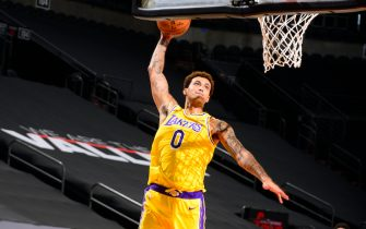 PHOENIX, AZ - DECEMBER 16: Kyle Kuzma #0 of the Los Angeles Lakers dunks in the game against the Phoenix Suns on December 16, 2020 at the Talking Stick Resort Arena in Phoenix, Arizona. NOTE TO USER: User expressly acknowledges and agrees that, by downloading and or using this Photograph, user is consenting to the terms and conditions of the Getty Images License Agreement. Mandatory Copyright Notice: Copyright 2020 NBAE (Photo by Barry Gossage/NBAE via Getty Images)