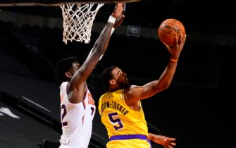 PHOENIX, AZ - DECEMBER 16: Talen Horton-Tucker #5 of the Los Angeles Lakers shoots in the game against the Phoenix Suns on December 16, 2020 at the Talking Stick Resort Arena in Phoenix, Arizona. NOTE TO USER: User expressly acknowledges and agrees that, by downloading and or using this Photograph, user is consenting to the terms and conditions of the Getty Images License Agreement. Mandatory Copyright Notice: Copyright 2020 NBAE (Photo by Barry Gossage/NBAE via Getty Images)