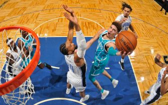 ORLANDO, FL - DECEMBER 17: LaMelo Ball #2 of the Charlotte Hornets drives to the basket against the Orlando Magic during a preseason game on December 17, 2020 at Amway Center in Orlando, Florida. NOTE TO USER: User expressly acknowledges and agrees that, by downloading and/or using this Photograph, user is consenting to the terms and conditions of the Getty Images License Agreement. Mandatory Copyright Notice: Copyright 2020 NBAE (Photo by Fernando Medina/NBAE via Getty Images)