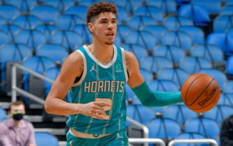 ORLANDO, FL - DECEMBER 17: LaMelo Ball #2 of the Charlotte Hornets dribbles the ball up court against the Orlando Magic during a preseason game on December 17, 2020 at Amway Center in Orlando, Florida. NOTE TO USER: User expressly acknowledges and agrees that, by downloading and/or using this Photograph, user is consenting to the terms and conditions of the Getty Images License Agreement. Mandatory Copyright Notice: Copyright 2020 NBAE (Photo by Fernando Medina/NBAE via Getty Images)