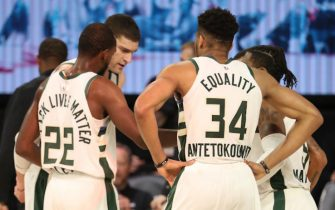Orlando, FL - SEPTEMBER 4: The Milwaukee Bucks huddle up during the game against the Miami Heat during Game Three of the Eastern Conference Semifinals on September 4, 2020 in Orlando, Florida at The Field House. NOTE TO USER: User expressly acknowledges and agrees that, by downloading and/or using this Photograph, user is consenting to the terms and conditions of the Getty Images License Agreement. Mandatory Copyright Notice: Copyright 2020 NBAE (Photo by Nathaniel S. Butler/NBAE via Getty Images)