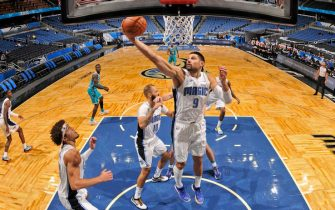 ORLANDO, FL - DECEMBER 17: Nikola Vucevic #9 of the Orlando Magic grabs a rebound against the Charlotte Hornets during a preseason game on December 17, 2020 at Amway Center in Orlando, Florida. NOTE TO USER: User expressly acknowledges and agrees that, by downloading and/or using this Photograph, user is consenting to the terms and conditions of the Getty Images License Agreement. Mandatory Copyright Notice: Copyright 2020 NBAE (Photo by Fernando Medina/NBAE via Getty Images)