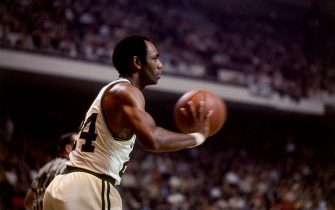BOSTON, MA - 1968: Sam Jones #24 of the Boston Celtics passes circa 1968 at the Boston Garden in Boston, Massachusetts. NOTE TO USER: User expressly acknowledges and agrees that, by downloading and or using this photograph, User is consenting to the terms and conditions of the Getty Images License Agreement. Mandatory Copyright Notice: Copyright 1968 NBAE (Photo by Dick Raphael/NBAE via Getty Images)