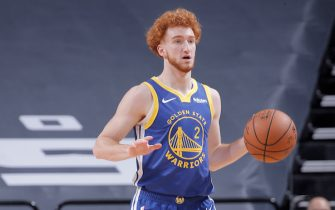 SACRAMENTO, CA - DECEMBER 15: Nico Mannion #2 of the Golden State Warriors brings the ball up the court against the Sacramento Kings on December 15, 2020 at Golden 1 Center in Sacramento, California. NOTE TO USER: User expressly acknowledges and agrees that, by downloading and or using this photograph, User is consenting to the terms and conditions of the Getty Images Agreement. Mandatory Copyright Notice: Copyright 2020 NBAE (Photo by Rocky Widner/NBAE via Getty Images)