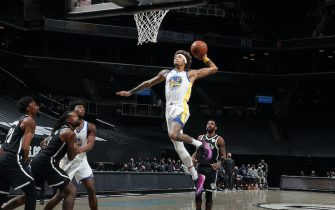 BROOKLYN, NY - DECEMBER 22: Kelly Oubre Jr. #12 of the Golden State Warriors shoots the ball during the game against the Brooklyn Nets on December 22, 2020 at Barclays Center in Brooklyn, New York. NOTE TO USER: User expressly acknowledges and agrees that, by downloading and or using this Photograph, user is consenting to the terms and conditions of the Getty Images License Agreement. Mandatory Copyright Notice: Copyright 2020 NBAE (Photo by Nathaniel S. Butler/NBAE via Getty Images)