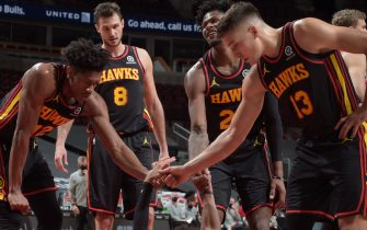 CHICAGO, IL - DECEMBER 23:  Trae Young #11 of the Atlanta Hawks is helped up by his teammates during the game against the Chicago Bulls at the United Center on December 23, 2020 in Chicago, Illinois. NOTE TO USER: User expressly acknowledges and agrees that, by downloading and/or using this Photograph, user is consenting to the terms and conditions of the Getty Images License Agreement. Mandatory Copyright Notice: Copyright 2020 NBAE (Photo by Randy Belice/NBAE via Getty Images)