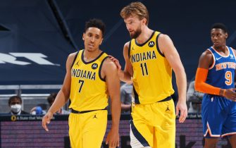 INDIANAPOLIS, IN - DECEMBER 23:  Domantas Sabonis #11 of the Indiana Pacers consoles teammate Malcolm Brogdon #7 during the game against the New York Knicks  on December 23, 2020 at Bankers Life Fieldhouse in Indianapolis, IN. NOTE TO USER: User expressly acknowledges and agrees that, by downloading and or using this Photograph, user is consenting to the terms and conditions of the Getty Images License Agreement. Mandatory Copyright Notice: Copyright 2020 NBAE (Photo by Ron Hoskins/NBAE via Getty Images)