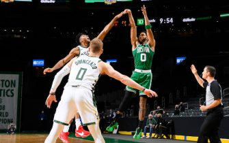 BOSTON, MA - DECEMBER 23: Jayson Tatum #0 of the Boston Celtics hits game winning shot during the game against the Milwaukee Bucks on December 23, 2020 at the TD Garden in Boston, Massachusetts. NOTE TO USER: User expressly acknowledges and agrees that, by downloading and or using this photograph, User is consenting to the terms and conditions of the Getty Images License Agreement. Mandatory Copyright Notice: Copyright 2020 NBAE (Photo by Brian Babineau/NBAE via Getty Images)