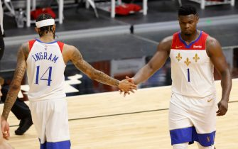 MIAMI, FLORIDA - DECEMBER 25: Brandon Ingram #14 and Zion Williamson #1 of the New Orleans Pelicans high five against the Miami Heat during the third quarter at American Airlines Arena on December 25, 2020 in Miami, Florida. NOTE TO USER: User expressly acknowledges and agrees that, by downloading and or using this photograph, User is consenting to the terms and conditions of the Getty Images License Agreement.  (Photo by Michael Reaves/Getty Images)